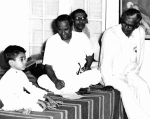 Vijay Siva, the child prodigy, identifies ragas as a three year old at the Music College in Chennai, watched by T.M. Thyagarajan and Prof. Balakrishnan