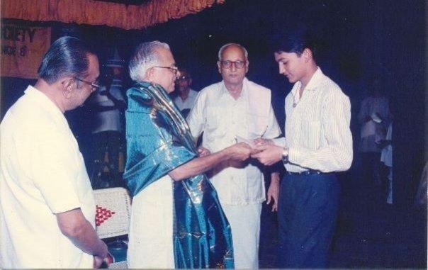K.V. Gopalakrishnan receiving his first 1st prize from Sangita Kalanidhi Prof. T.N. Krishnan, in 1992.