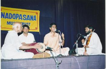 K.V. Gopalakrishnan in concert with Shri Palghat Raghu. No prizes for identifying the vocalist and violinist!