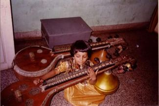 Three year old Sriranjani playing the veena