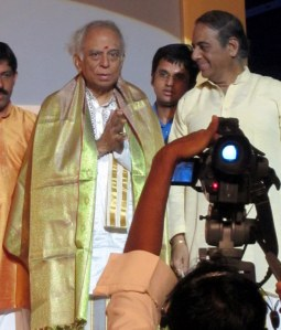 Saketharaman stands behind his guru Lalgudi Shri Jayaraman and maestro Madurai Shri T.N. Seshagopalan (at Shri Jayaraman's 80th birthday celebrations in 2010)